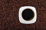Free Stock Photo: A cup of coffee on a bean background.