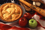 Free Stock Photo: An American pie display with apples, a flag, and baseball equipment.