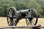 Free Stock Photo: A Civil War era cannon on the edge of a field.