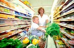 Free Stock Photo: Woman and child grocery shopping.