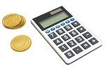 Free Stock Photo: A calculator and a stack of gold coins.