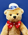 Free Stock Photo: Close-up of a patriotic teddy bear isolated on a blue background.