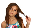 Free Stock Photo: A pretty young girl pulling on her hair.