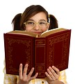 Free Stock Photo: A smart girl with glasses reading a book.