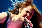 Free Stock Photo: Miley Cyrus singing on stage.