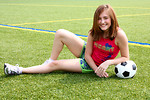 Free Stock Photo: A cute young girl posing with a soccer ball.