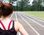 Free Stock Photo: A cute young girl on a track field.