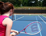Free Stock Photo: A cute young girl playing tennis.