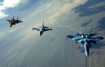 Free Stock Photo: Two F-15 Eagles and an F-16 Fighting Falcon from the 64th Aggressor Squadron at Nellis Air Force Base, Nev., head to the 