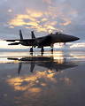 Free Stock Photo: An F-15E Strike Eagle sits on the flightline during sunset Dec. 6, 2010, at Mountain Home Air Force Base, Idaho. With a digital electronic engine control system, F-15E pilots can accelerate from idle power to maximum afterburner in less than four seconds. Faster engine acceleration means quicker takeoffs and crisper response while maneuvering. The F-15E is assigned to the 391st Fighter Squadron.