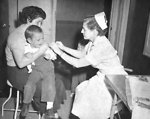 Free Stock Photo: This photograph depicted a small child as he received a smallpox vaccination at a local health department.
