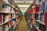 Free Stock Photo: This 2005 image depicted an aisle of bookshelves inside the CDC\'s Information Center, a public health-related library, which has a collection of over 100,000 volumes, as well as state-of-the-art computer capabilities. The library is located in the new Tom Harkin Global Communications Center located on the CDC\'s Roybal Campus in Atlanta, Georgia. In this particular image, shelved periodicals are seen displayed along the library entrance walls.