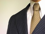 Free Stock Photo: Closeup of a business man in a blue suit and tie.