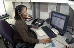 Free Stock Photo: A Cancer Information Service (CIS) staffer (African-American female) answers a call from a customer.