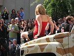 Free Stock Photo: Beautiful girl on the hood of a military truck in the 2008 Dragoncon parade.
