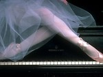 Free Stock Photo: Closeup of a ballerina's legs posing on a piano.