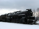 Free Stock Photo: A steam locomotive under a stormy winter sky.