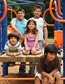 Free Stock Photo: A group of latino kids posing on a playground.