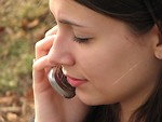 Free Stock Photo: Closeup of a teen girl talking on a cell phone.