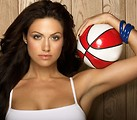 Free Stock Photo: A beautiful woman posing with a basketball.