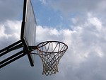 Free Stock Photo: An outdoor basketball hoop with a cloudy sky background.