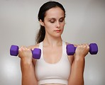 Free Stock Photo: A beautiful young woman exercising with weights.