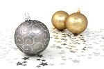 Free Stock Photo: Silver and gold Christmas ornaments with silver stars on a white floor.
