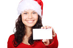 Free Stock Photo: A beautiful young woman with a Christmas hat and a blank business card.