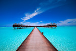 Free Stock Photo: A bridge leading to water bungalows on the ocean