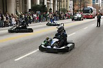 Free Stock Photo: Men in go-karts at the 2010 Atlanta Saint Patrick's Day Parade.