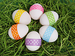 Free Stock Photo: Easter eggs with ribbons on grass.