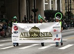 Free Stock Photo: Kids carrying a sign to open the 2010 Saint Patricks Day Parade in Atlanta, Georgia