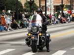 Free Stock Photo: A police officer on a motorycle in the 2010 Saint Patricks Day Parade in Atlanta, Georgia.