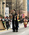 Free Stock Photo: A juggler on stilts and other medieval actors in the 2010 Saint Patricks Day Parade in Atlanta, Georgia