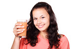 Free Stock Photo: A beautiful woman holding a glass of juice.