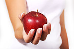 Free Stock Photo: Close-up of a woman holding a red apple in her hand.