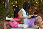 Free Stock Photo: Two cute young girls reading books outdoors