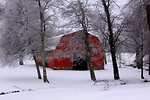 Free Stock Photo: A red barn surrounded by snow