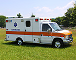 Free Stock Photo: An ambulance parked on the grass
