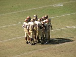 Free Stock Photo: A football team in a huddle on a field