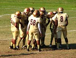 Free Stock Photo: Football players in a huddle on a field
