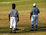 Free Stock Photo: Football referees standing on a field
