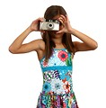Free Stock Photo: A pretty young girl taking a picture with a camera