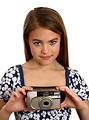 Free Stock Photo: A beautiful young girl holding a camera