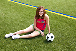 Free Stock Photo: A cute young girl posing with a soccer ball