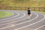 Free Stock Photo: A cute young girl running on a track field
