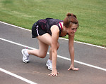 Free Stock Photo: A cute young girl on a track field preparing to race