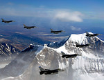 Free Stock Photo: Fighter jets flying in formation above mountains