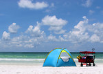 Free Stock Photo: A tent and buggy on a beach.