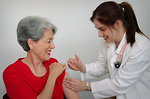 Free Stock Photo: A senior woman receiving a vaccination shot from her doctor